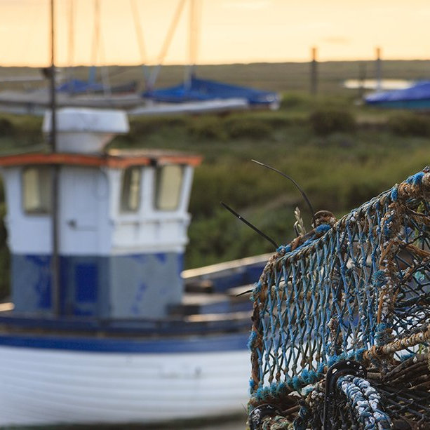 Brancaster Staithe Harbour - Once a busy port, sailing ships carried cargo of coal and grain, for a malt house said to be the biggest in England. Trade declined in the 1800s, but a thriving fishing industry survives, and today the harbour bustles with pleasure craft.