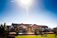 Briarfields Hotel - Relax & enjoy fabulous food & rooms, located between RSPB Titchwell & the Royal West Norfolk Golf course. Family & dog-friendly. Sit by a wood burner with the papers & a pint, or enjoy a glass of Pimms on the decking with views over the salt marshes.