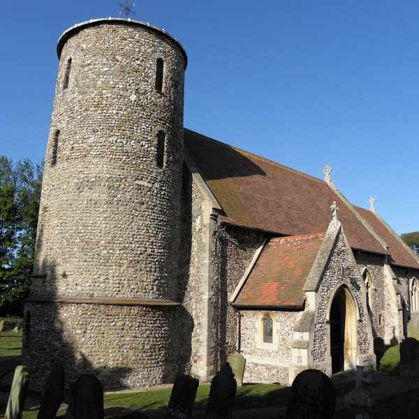 St Marys Church - This little church in its coastal village deserves fame for its three outstanding features:- its Saxon round tower (pre-Conquest of 1066), its Norman font, and its collection of medieval glass.